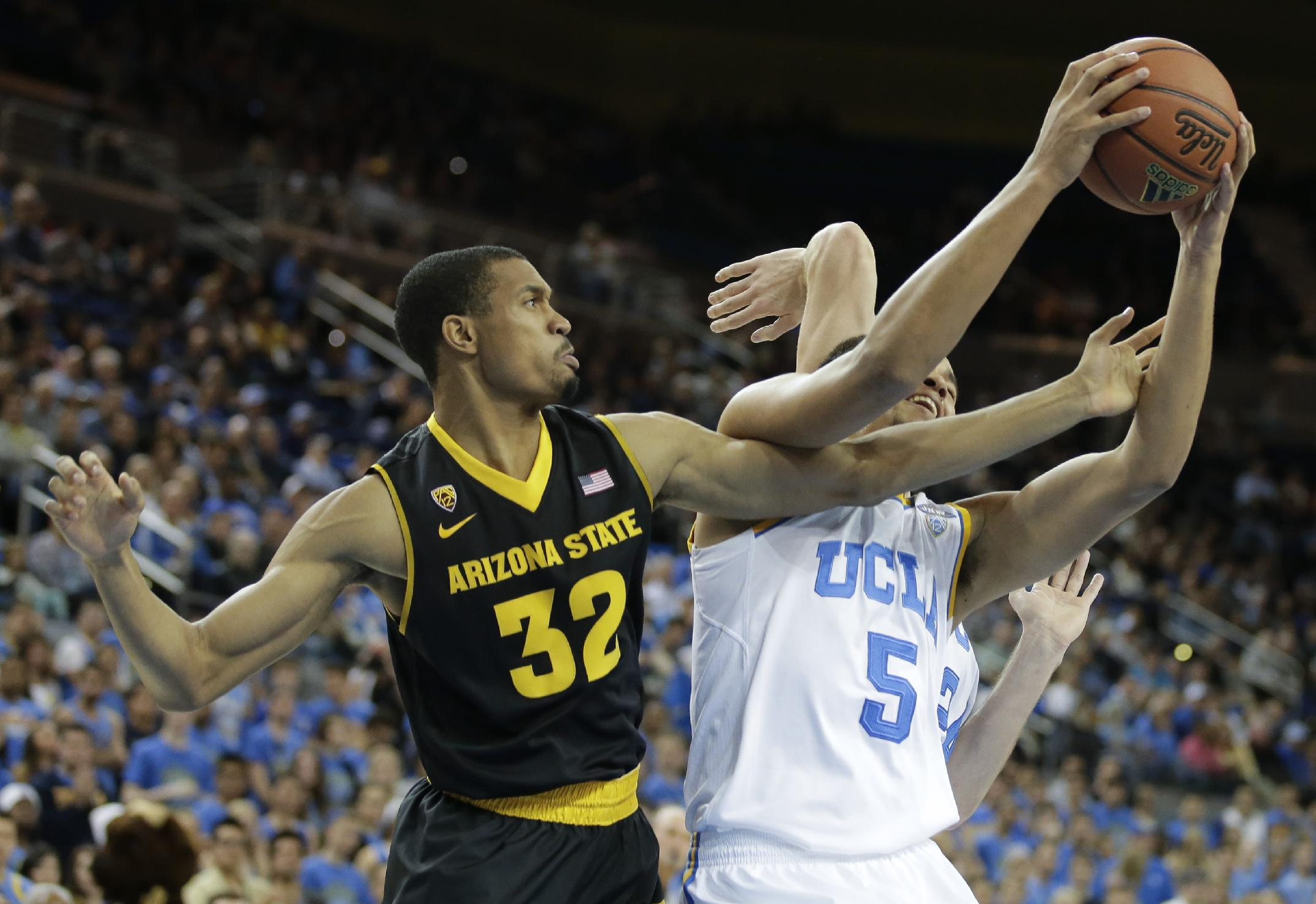 UCLA guard Kyle Anderson, right, pulls a rebound away from Arizona State forward Brandan Kearney during the first half of an NCAA college basketball game in Los Angeles, Sunday, Jan. 12, 2014
