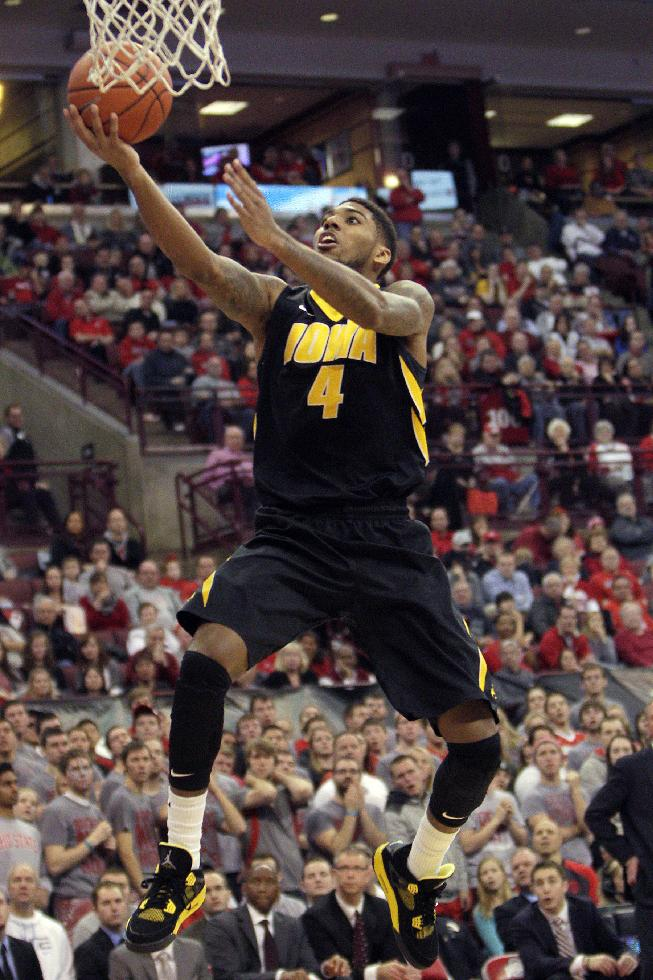 In this Jan. 12, 2014, file photo, Iowa's Roy Devyn Marble goes to the basket during an NCAA college basketball game against Ohio State in Columbus, Ohio. Marble has evolved into one of the Big Ten's top offensive threats