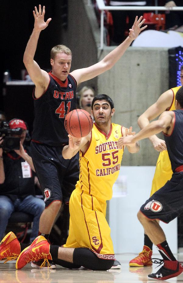 Southern California's Omar Oraby (55), of Egypt, passes the ball as Utah's Jeremy Olsen (41) defends in the second half during an NCAA basketball game Thursday, Jan. 16, 2014, in Salt Lake City. Utah won 84-66