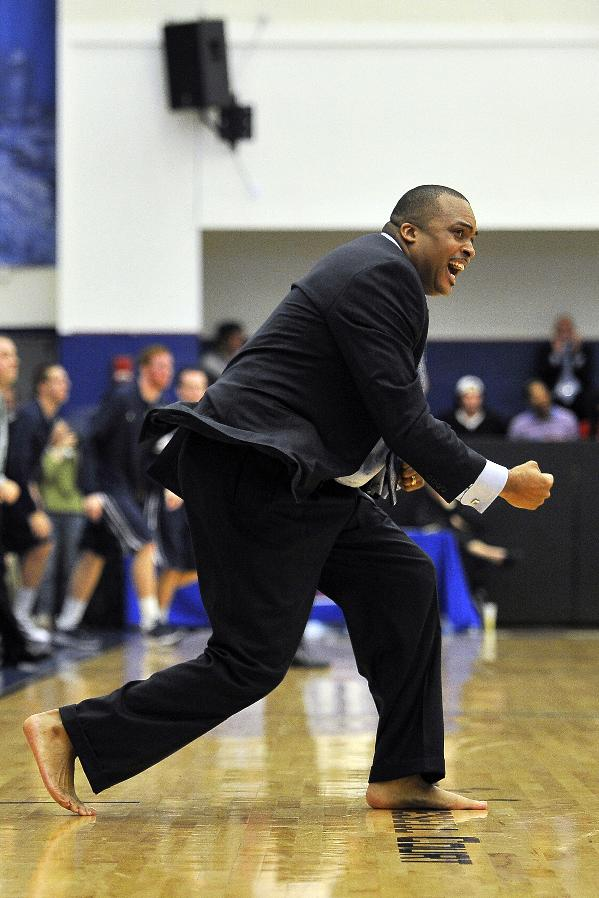 In this image taken on Jan. 12, 2012, and provided by Georgia State,  Georgia State coach Ron Hunter, coaching barefoot, reacts during an NCAA college basketball game against North Carolina-Wilmington in Atlanta. Hunter coaches one game each year barefooted to bring attention to his charity that provides shoes to millions of poor children around the world