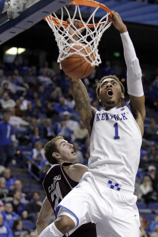 Kentucky's James Young (1) dunks next to Texas A&M's Alex Caruso during the second half of an NCAA college basketball game, Tuesday, Jan. 21, 2014, in Lexington, Ky. Kentucky won 68-51
