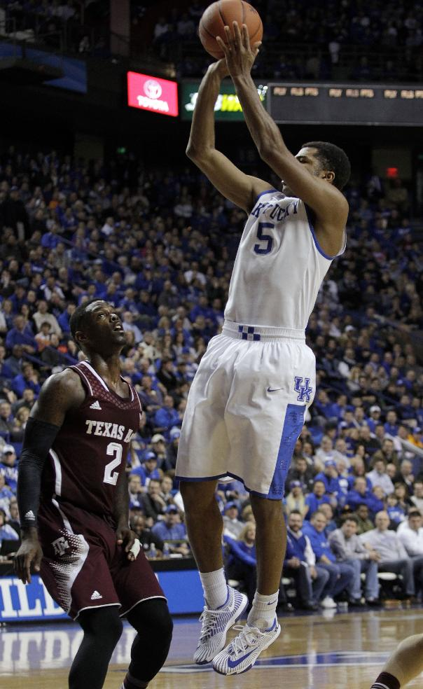 Kentucky's Andrew Harrison (5) shoots over Texas A&M's Shawn Smith during the second half of an NCAA college basketball game, Tuesday, Jan. 21, 2014, in Lexington, Ky. Kentucky won 68-51