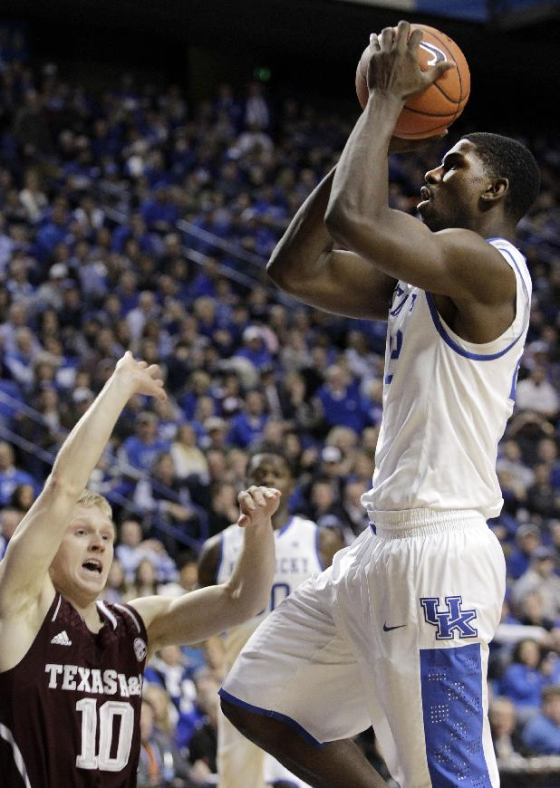 Kentucky's Alex Poythress, right, shoots near Texas A&M's Blake McDonald (10) during the second half of an NCAA college basketball game, Tuesday, Jan. 21, 2014, in Lexington, Ky. Kentucky won 68-51
