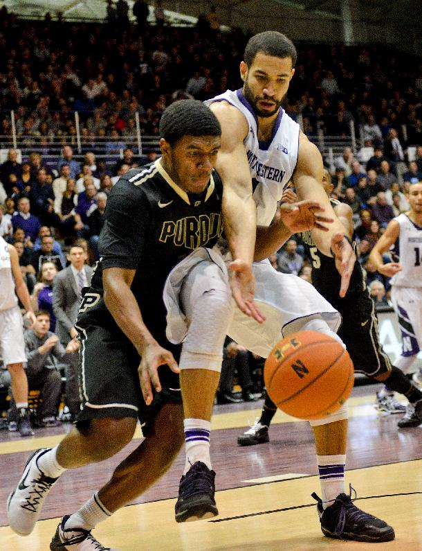 Northwestern's Drew Crawford (1) and Purdue guard Ronnie Johnson (3) fight for a ball during the second half of an NCAA college basketball game in Evanston, Ill., on Tuesday, Jan. 21, 2014