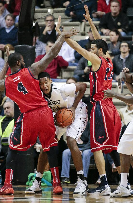 Vanderbilt center Damian Jones (30) is caught between Mississippi defenders Demarco Cox (4) and Anthony Perez (13) in the first half of an NCAA college basketball game Wednesday, Jan. 22, 2014, in Nashville, Tenn
