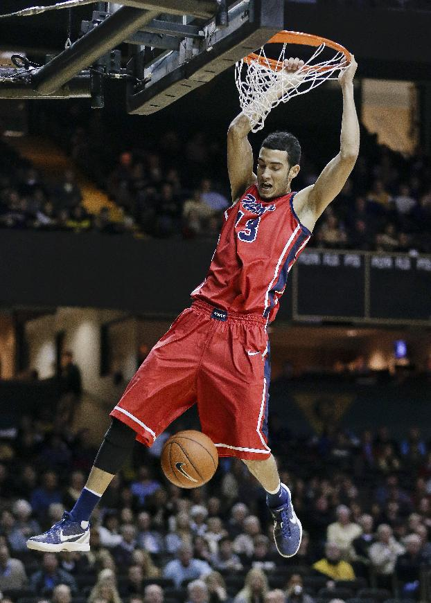 Mississippi forward Anthony Perez dunks the ball against Vanderbilt in the first half of an NCAA college basketball game Wednesday, Jan. 22, 2014, in Nashville, Tenn