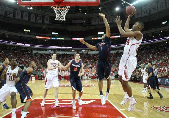 In this Jan. 11, 2014, file photo, North Carolina State's T.J. Warren (24) shoots against Virginia in Raleigh, N.C. Warren, a sophomore, is leading the Atlantic Coast Conference in scoring by a big margin and is the top scorer among all power-conference teams