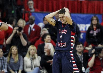 Tyler Johnson of Fresno State reacts as his team heads to overtime against UNLV during their NCAA basketball game at the Thomas & Mack Center in Las Vegas Saturday, Jan. 25, 2014