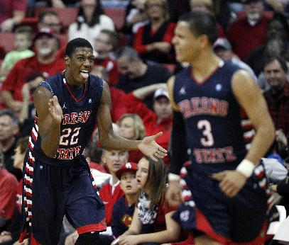 Paul Watson of Fresno State celebrates after scoring during a NCAA basketball game against UNLV at the Thomas & Mack Center in Las Vegas Saturday, Jan. 25, 2014