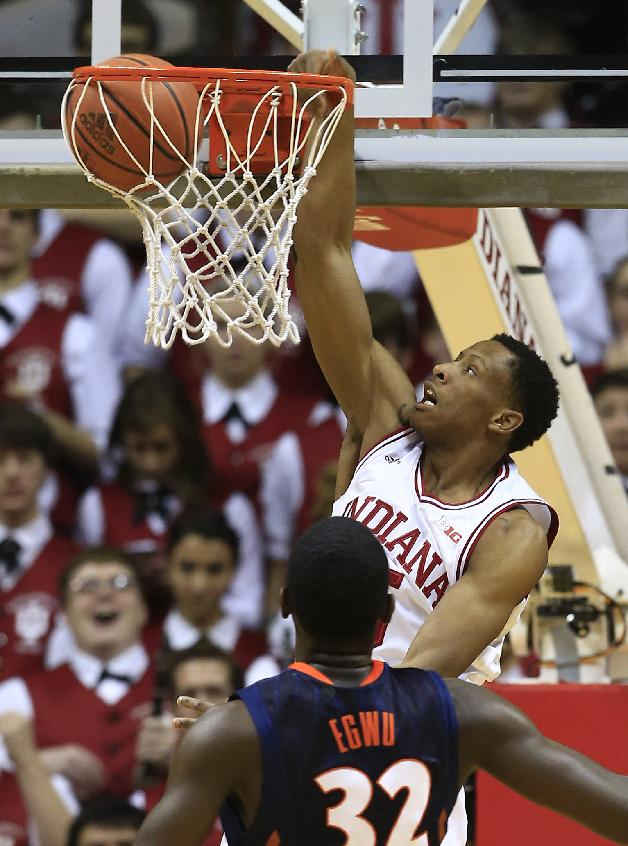 Indiana's Troy Williams (5) dunks against Illinois' Nnanna Egwu (32) during the first half of an NCAA college basketball game, Sunday, Jan. 26, 2014, in Bloomington, Ind