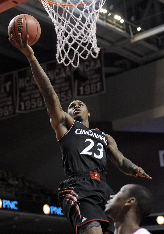 Cincinnati's Sean Kilpatrick (23) shoots over Temple's Will Cummings during the first half of an NCAA college basketball game on Sunday, Jan. 26, 2014, in Philadelphia. Cincinnati won 80-76