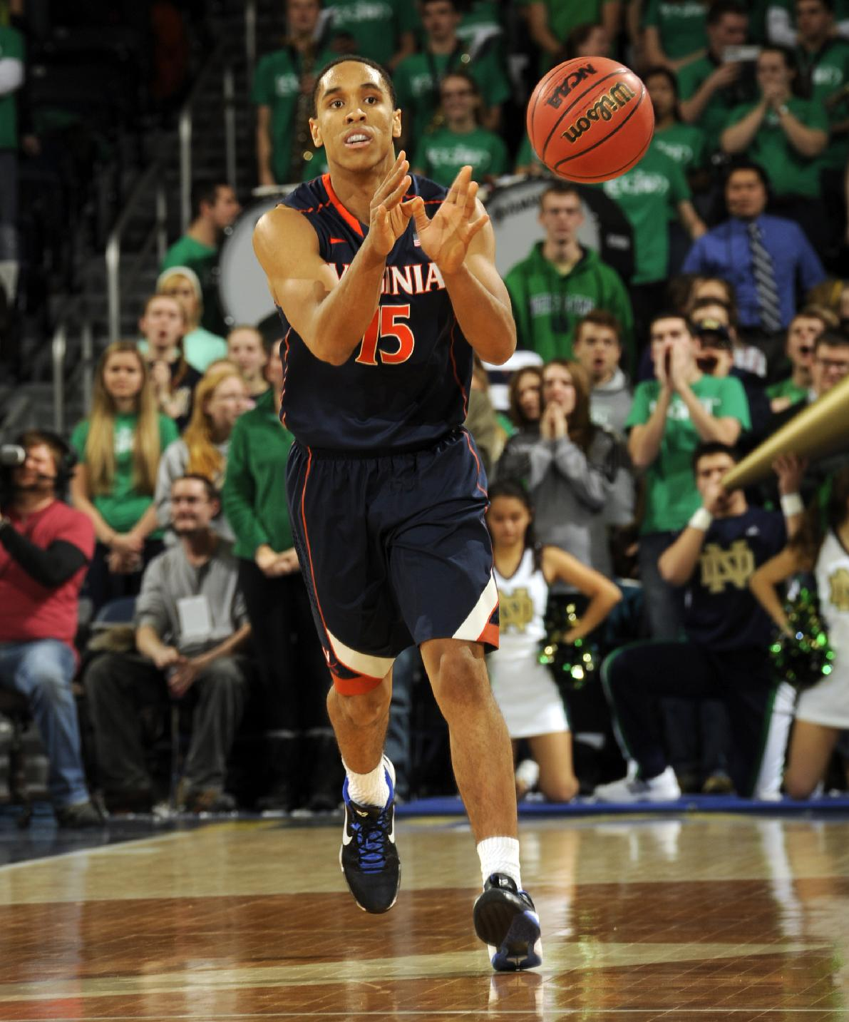 Virginia guard Malcolm Brogdon passes the ball during the first half of a, NCAA college basketball game against Notre Dame, Tuesday, Jan. 28, 2014, in South Bend, Ind