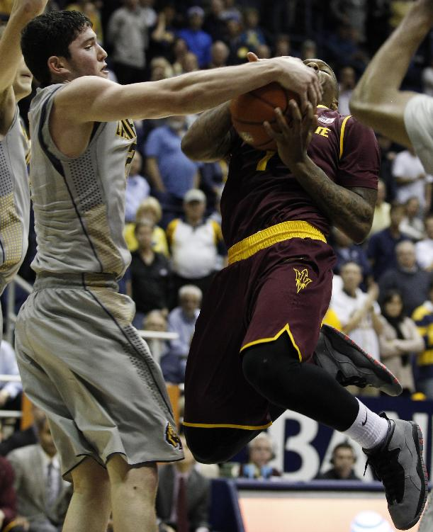 California's Sam Singer, left, struggles for the ball with Arizona State's Jahii Carson during the second half of an NCAA college basketball game, Wednesday, Jan. 29, 2014 in Berkeley, Calif