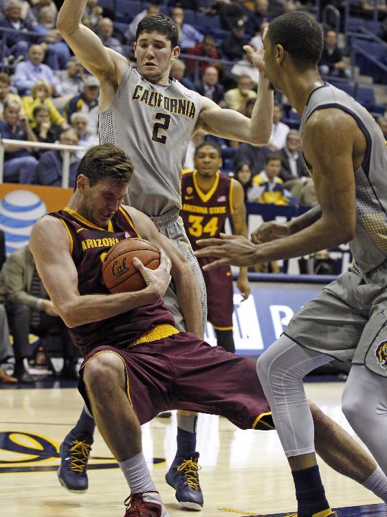 Arizona State's Jordan Bachynski falls back between California's Sam Singer (2) and Richard Solomon, front, during the second half of an NCAA college basketball game, Wednesday, Jan. 29, 2014 in Berkeley, Calif