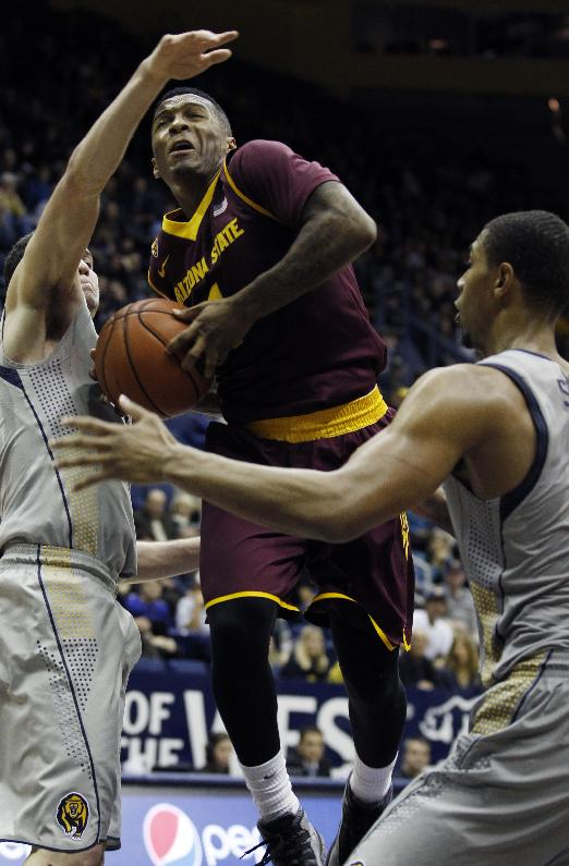 Arizona State's Jahii Carson, center, goes up between California's Sam Singer, left, and Richard Solomon during the second half of an NCAA college basketball game, Wednesday, Jan. 29, 2014 in Berkeley, Calif