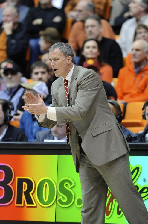 USC's head coach, Andy Enfield, makes calls against Oregon State during the second half of an NCAA college basketball game in Corvallis, Ore., Thursday Jan. 30, 2014. Oregon State beat USC 76-75 in overtime