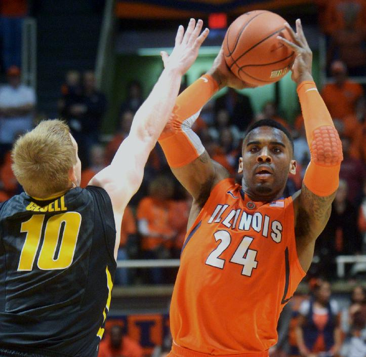 Illinois' Rayvonte Rice (24) looks to pass against Iowa's guard Mike Gesell's (10) defense during an NCAA college basketball game in Champaign, Ill., Saturday, Feb. 1, 2014