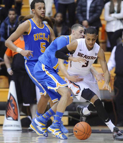 Oregon State's Hallice Cooke (3) drives against UCLA's Zach LaVine (14) and Kyle Anderson (5) during the second half of an NCAA college basketball game in Corvallis, Ore., Sunday, Feb. 2, 2014. Oregon State won 71-67