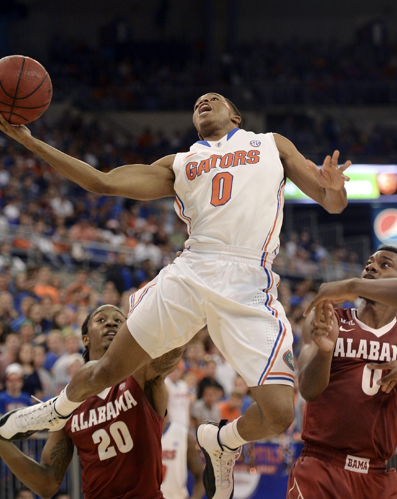 Florida's Kasey Hill goes up for two points as Alabama guard Levi Randolph (20) and Algie Key (0) look on during the first half of an NCAA college basketball game Saturday, Feb. 8, 2014, in Gainesville, Fla