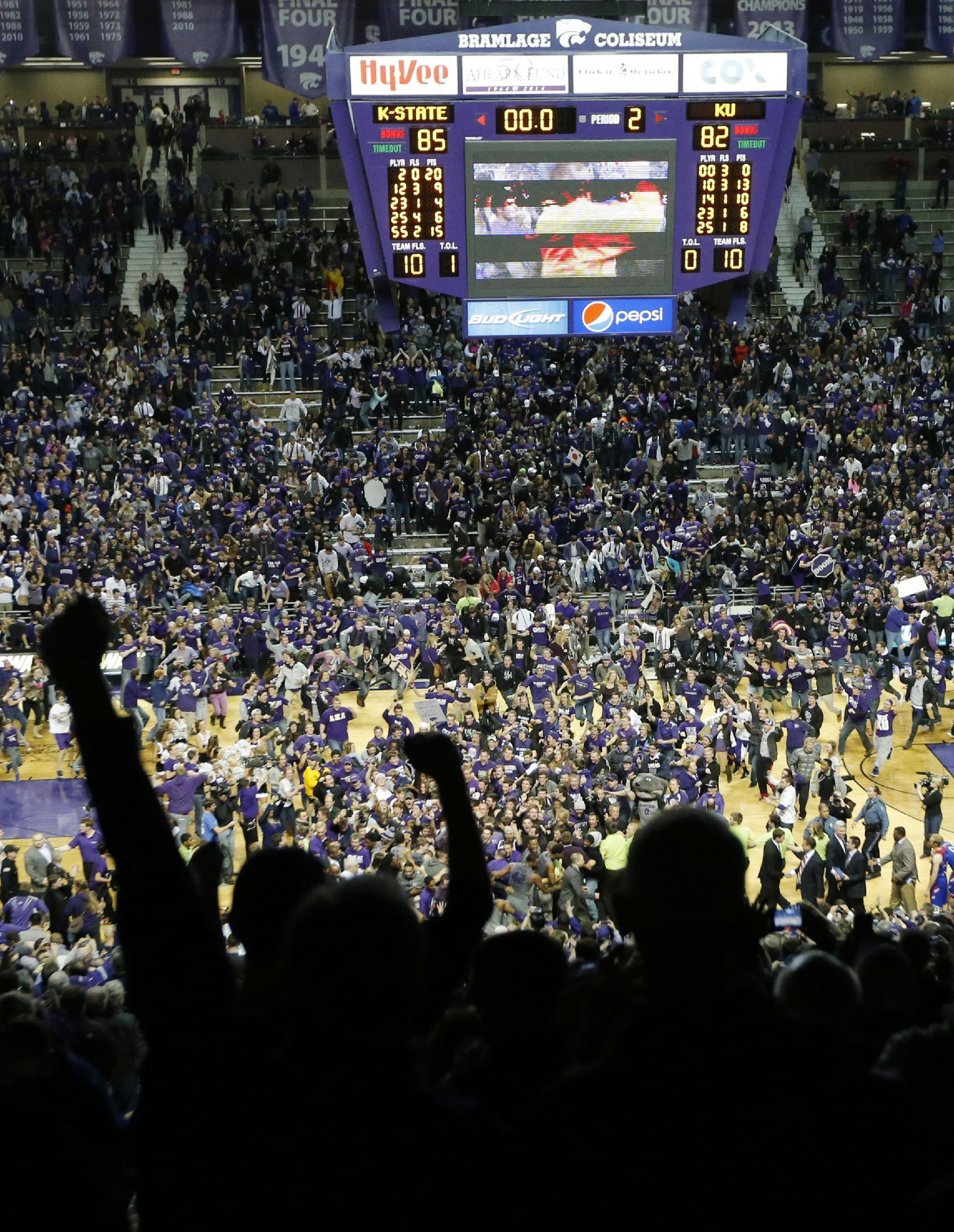 Kansas State fans celebrate following an NCAA college basketball game against Kansas in Manhattan, Kan., Monday, Feb. 10, 2014. Kansas State defeated Kansas 85-82 in overtime