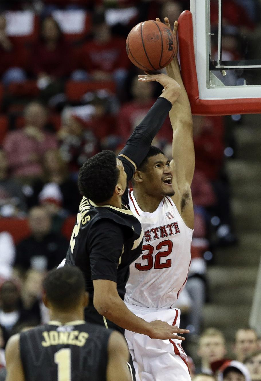 North Carolina State's Kyle Washington (32) drives to the basket as Wake Forest's Devin Thomas defends during the second half of an NCAA college basketball game in Raleigh, N.C., Tuesday, Feb. 11, 2014. North Carolina State won 82-67