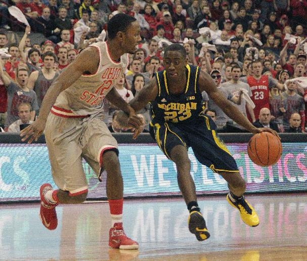 Michigan's Caris LeVert, right, drives the lane as Ohio State's Sam Thompson defends during the first half of an NCAA college basketball game, Tuesday, Feb. 11, 2014, in Columbus, Ohio