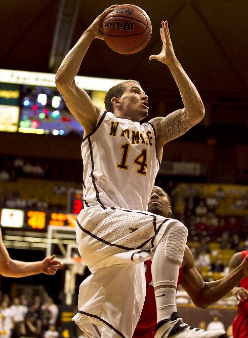 University of Wyoming guard Josh Adams (14) carries the ball up to the net Tuesday, Feb. 11, 2014 against San Diego State at the Arena-Auditorium in Laramie, Wyo