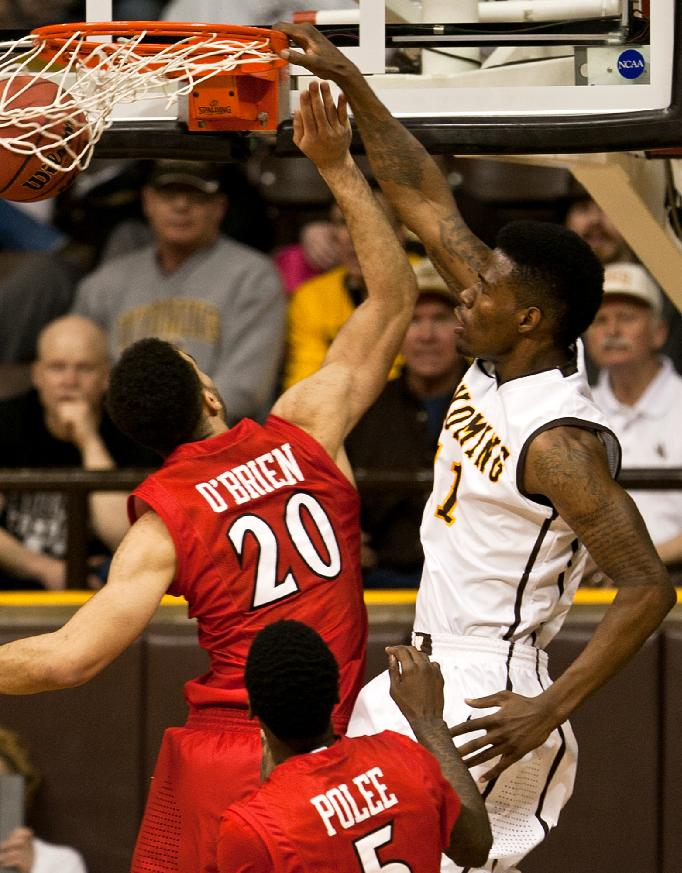 Univeristy of Wyoming forward Derek Cooke Jr.slams the ball down on San Diego State's JJ O'Brien (20) in the Cowboys victory over the Aztecs Tuesday, Feb. 11, 2014 during a mens NCAA basketball game at the Arena- Auditorium in Laramie, Wyo