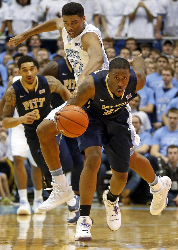 Pittsburgh's Lamar Patterson (21) takes the ball away from North Carolina's Isaiah Hicks (22) during the second half of an NCAA college basketball game in Chapel Hill, N.C., Saturday, Feb. 15, 2014. Patterson had 16 points in Pittsburgh's 75-71 loss to North Carolina