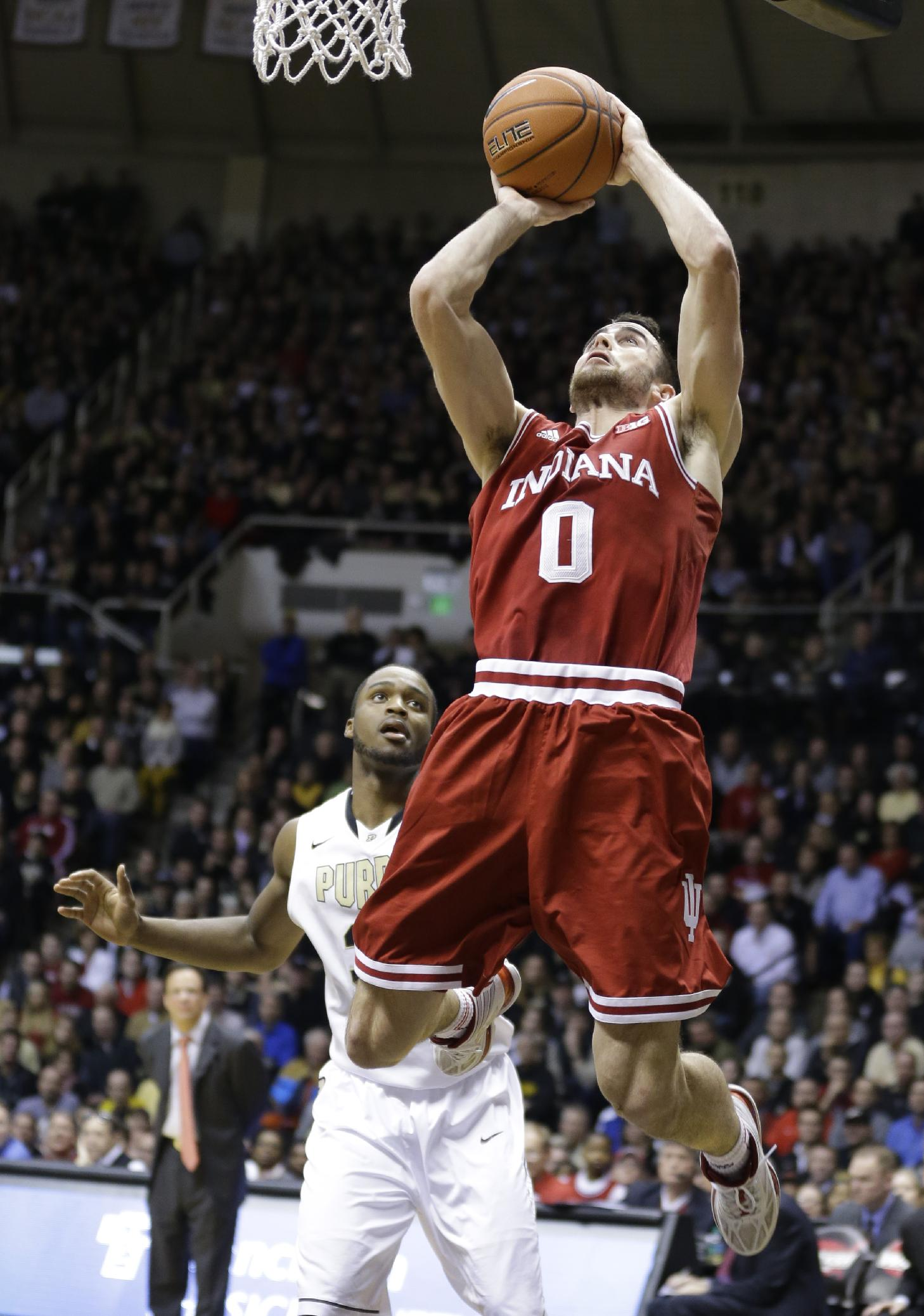 Indiana forward Will Sheehey (0) shoots in front of Purdue guard Rapheal Davis in the second half of an NCAA college basketball game in West Lafayette, Ind., Saturday, Feb. 15, 2014. Purdue defeated Indiana 82-64