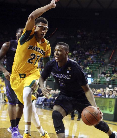 Kansas State guard Marcus Foster (2) drives on Baylor center Isaiah Austin (21) in the first half of an NCAA college basketball game Saturday, Feb. 15, 2014, in Waco, Texas