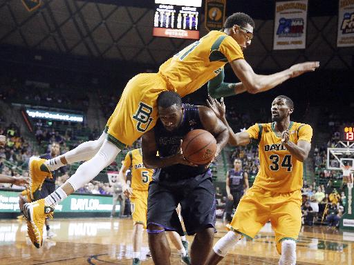 Baylor center Isaiah Austin, top, falls on Kansas State forward Thomas Gipson, bottom, as Baylor forward Cory Jefferson (34) stands at right in the first half of an NCAA college basketball game, Saturday, Feb. 15, 2014, in Waco, Texas