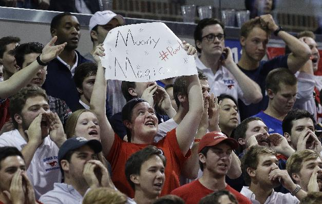 In this Feb. 8, 2014, photo, an SMU fan holds up a sign at Moody Coliseum during the first half of an NCAA college basketball game between Cincinnati and SMU in Dallas. Three decades after an unusual Dallas Mavericks' playoff game on the SMU campus spawned Moody Madness, the Mustangs are undefeated at home this season