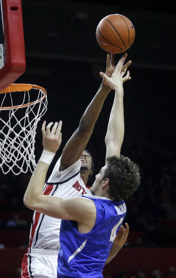 Rutgers forward Kadeem Jack blocks a shot by Memphis forward Austin Nichols (4) during the first half of an NCAA college basketball game Thursday, Feb. 20, 2014, in Piscataway, N.J