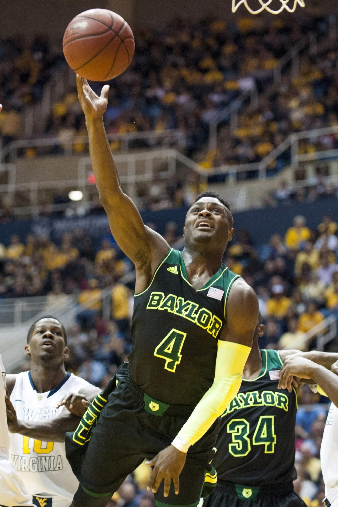 Baylor's Gary Franklin (4) drives to the basket during the second half of an NCAA college basketball game Saturday, Feb. 22, 2014, in Morgantown, W.Va. Baylor won 88-75