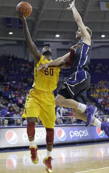 Iowa State guard DeAndre Kane (50) shoots against TCU guard Christian Gore (13) during the first half of an NCAA college basketball game Saturday, Feb. 22, 2014, in Fort Worth, Texas. Iowa State won 71-60