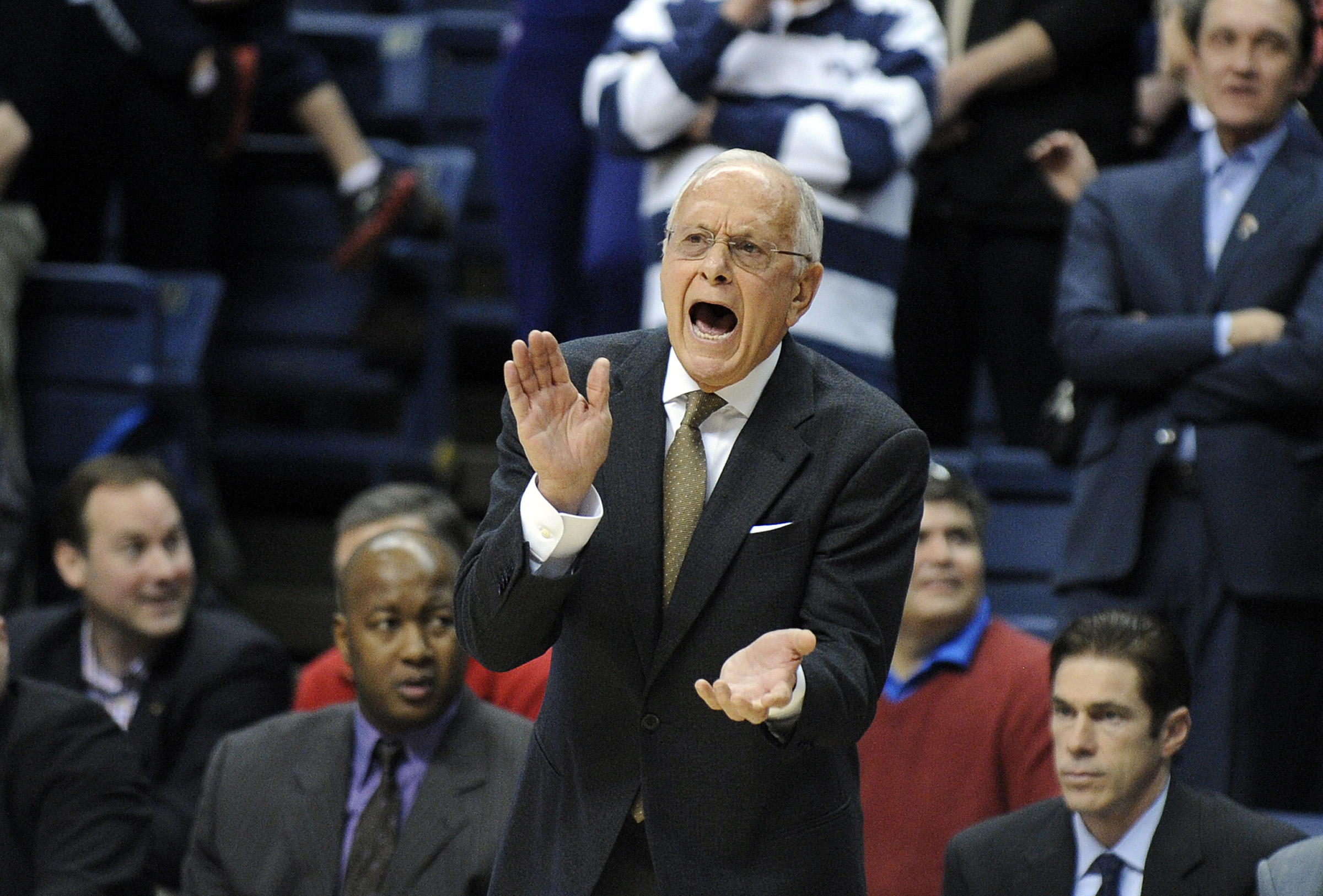 SMU head coach Larry Brown encourages his team during the first half of SMU's 64-55 victory over Connecticut in an NCAA college basketball game in Storrs, Conn., Sunday, Feb. 23, 2014