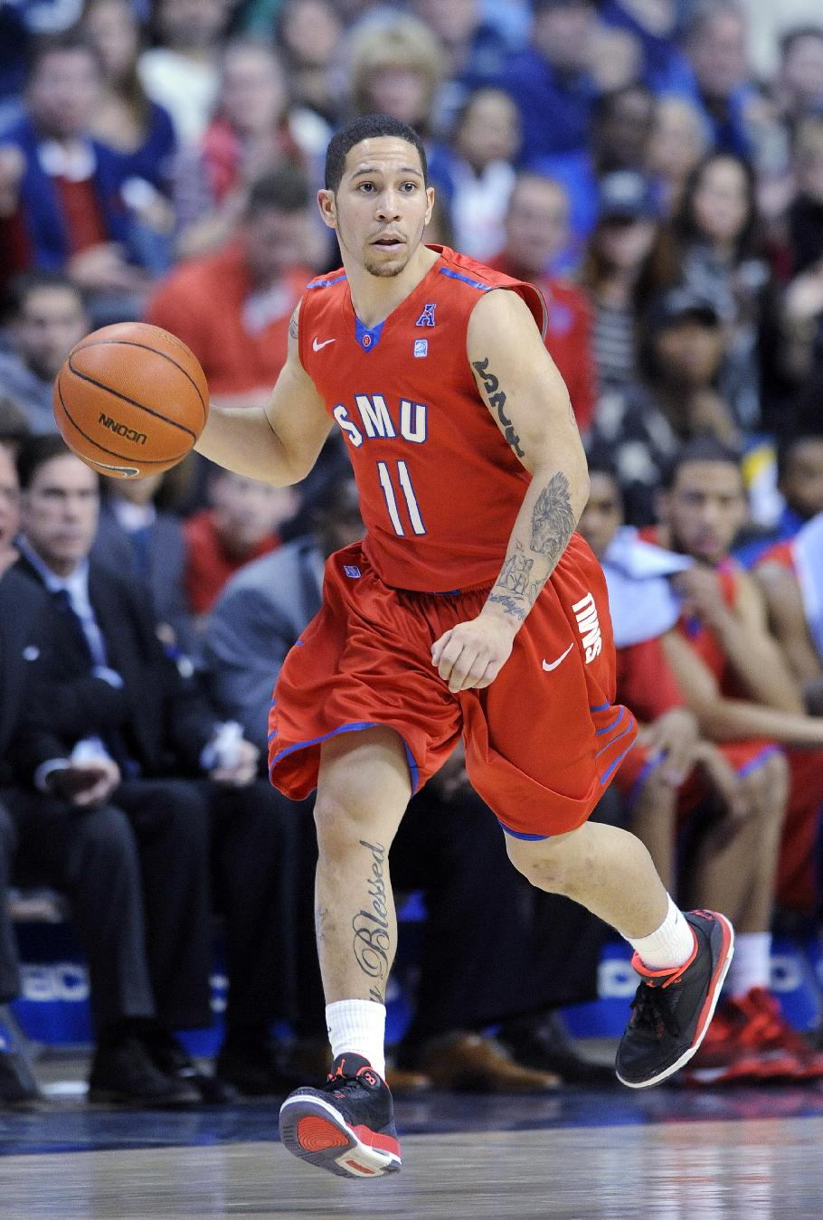 SMU's Nic Moore (11) runs the court during the second half of his team's 64-55 victory over Connecticut in an NCAA college basketball game in Storrs, Conn., Sunday, Feb. 23, 2014
