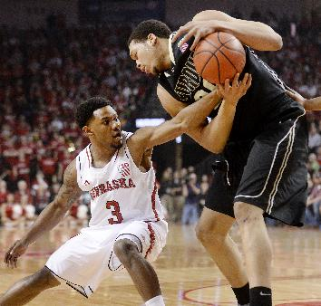 Nebraska guard Benny Parker (3) reaches in to strip the ball from Purdue center A. J. Hammons, right, during the first half of an NCAA college basketball game in Lincoln, Neb., on Sunday, Feb. 23, 2014