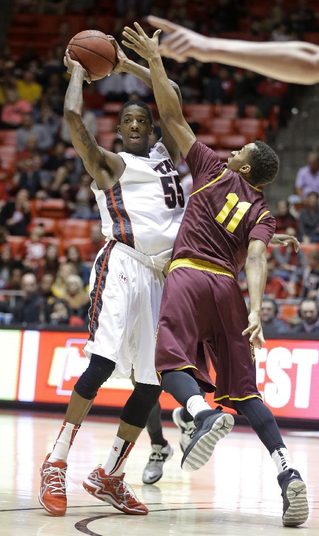 Utah's Delon Wright (55) passes the ball as Arizona State's Calaen Robinson (11) defends in the second half of an NCAA college basketball game, Sunday, Feb. 23, 2014, in Salt Lake City. Utah won 86-63