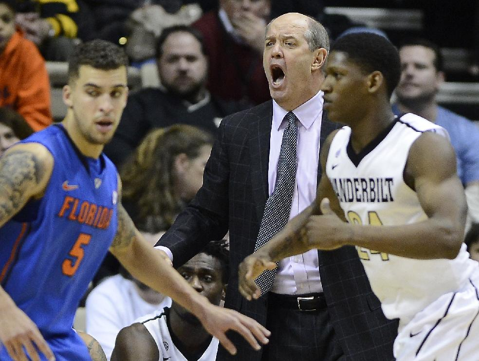 Vanderbilt head coach Kevin Stallings yells at his players as guard Dai-Jon Parker, right, is defended by Florida guard Scottie Wilbekin (5) in the second half of an NCAA college basketball game, Tuesday, Feb. 25, 2014, in Nashville, Tenn. Florida won 57-54