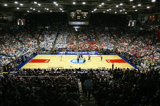 This March 19, 2006 file photo  shows an NCAA tournament game between George Mason and North Carolina being played at Dayton Arena in Dayton, Ohio. Dayton will host the NCAA First Four games this season and the NCAA has ruled that if Dayton is ruled eligible to be one of the First Four teams that they would be allowed to play on their home court