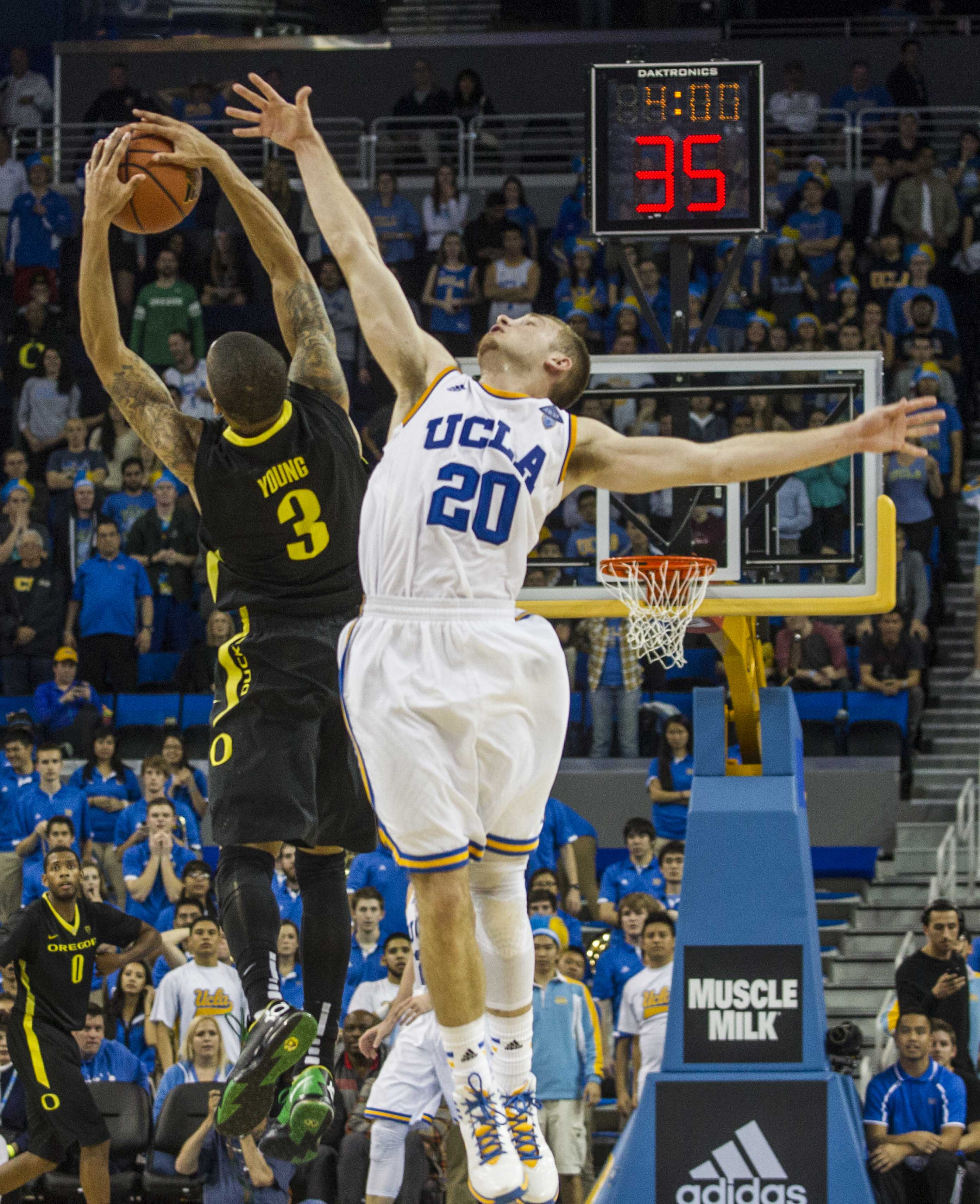 Oregon guard Joseph Young, left, and UCLA guard Bryce Alford, right, battle for a ball in the second half of an NCAA college basketball game Thursday, Feb. 27, 2014, in Los Angeles. Oregon 87-83 double overtime win over UCLA. Young scored a team-high 26 points. Alford scored a game-hight 31 points