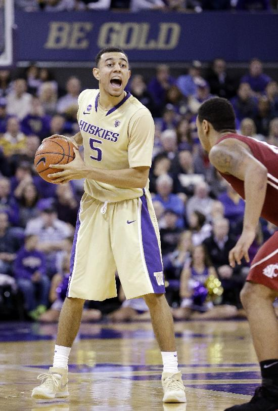 Washington's Nigel Williams-Goss directs his team against Washington State in the second half of an NCAA college basketball game Friday, Feb. 28, 2014, in Seattle. Washington won 72-49