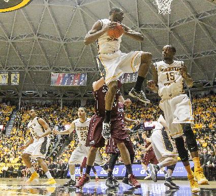 Wichita State's Kadeen Coleby goes high to rebound against Missouri State in the first halfof an NCAA college basketball game in Wichita, Kan., Saturday, March 1, 2014