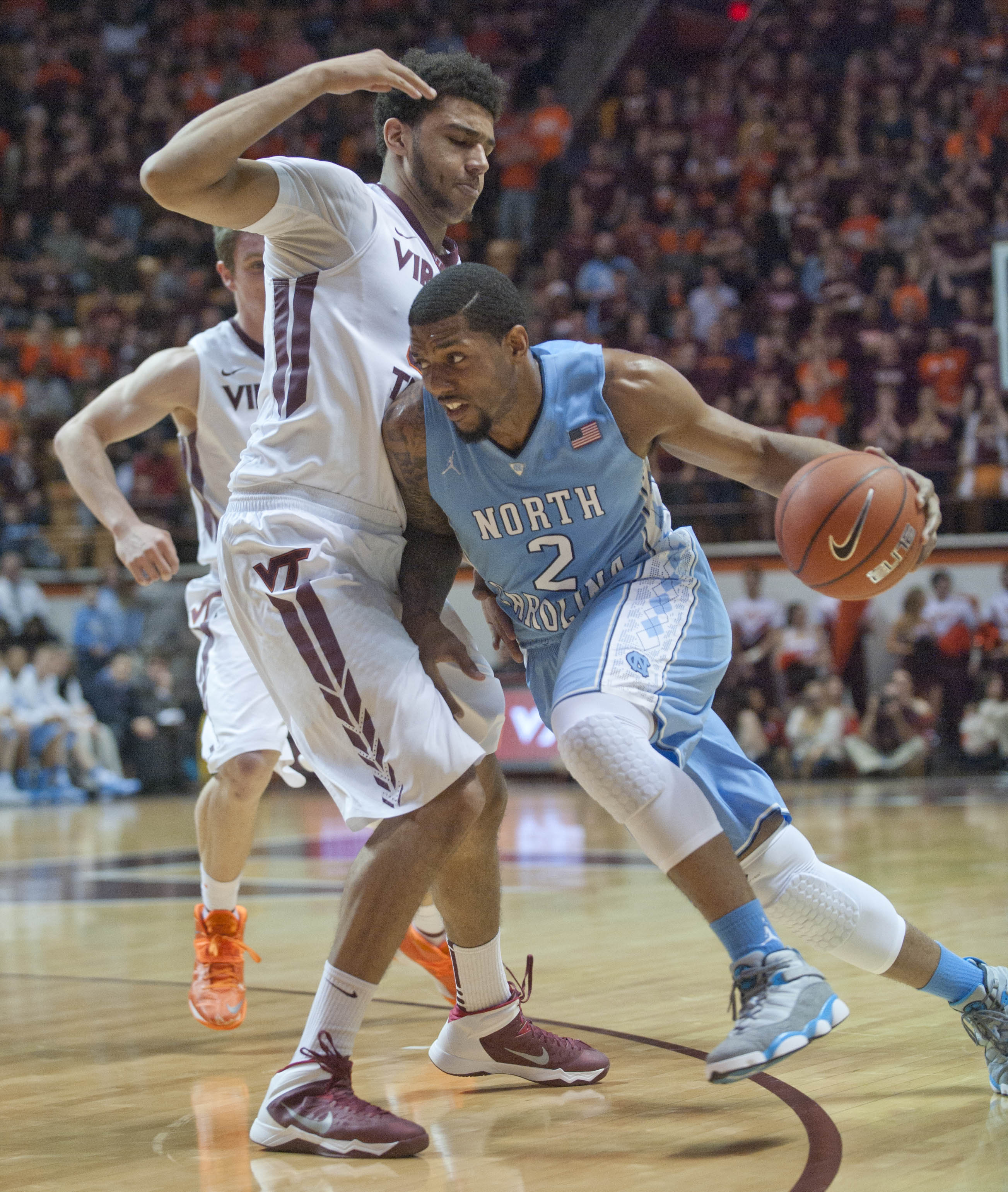 North Carolina's Leslie McDonald (2) drives on Virginia Tech's Marshall Wood during the first half of an NCAA college basketball game,  Saturday, March 1, 2014, in Blacksburg, Va