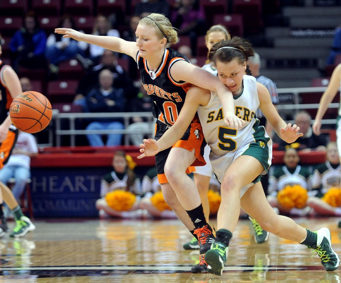 St. Thomas More's Elizabeth Bristow (5) and  Prophetstown's Kassi Henrekin (10) chase after a loose ball in the first half of the IHSA Girls' Basketball Class 2A State Championship game at Illinois State University's Redbird Arena in Normal, Ill.,  on Saturday, March 1, 2014