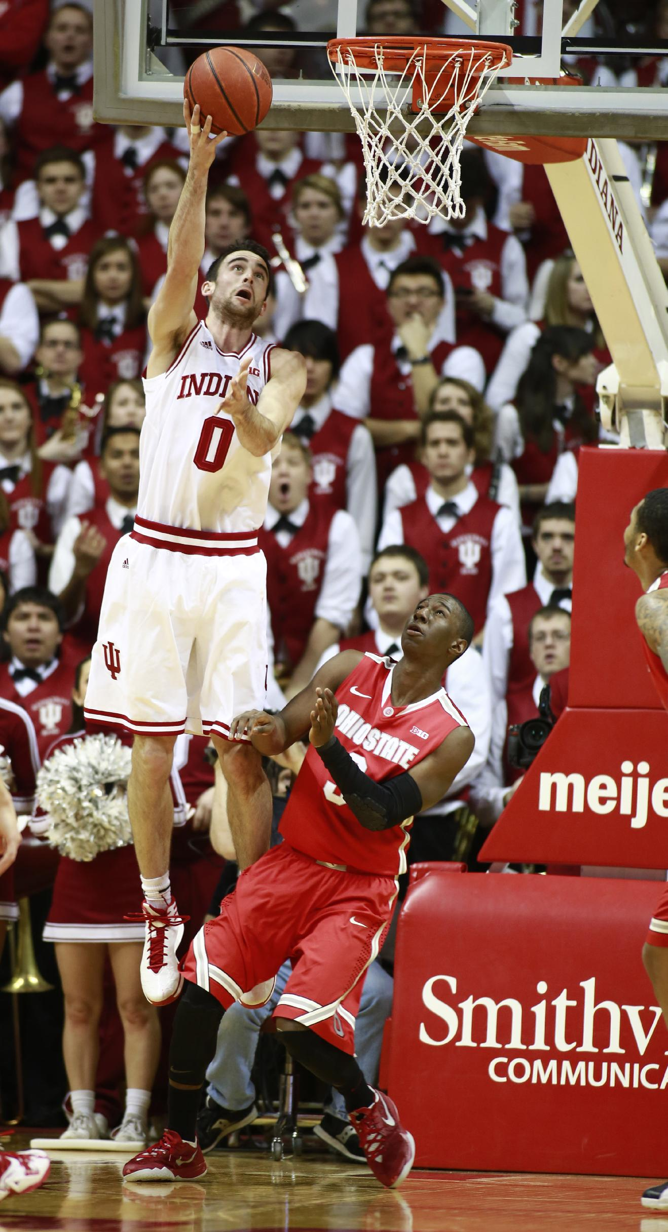 Indiana forward Will Sheehey (0) shoots the basketball defended by Ohio State guard Shannon Scott in the first half of an NCAA basketball game in Bloomington, Ind. Sunday, March 2, 2014. Indiana won 72-64