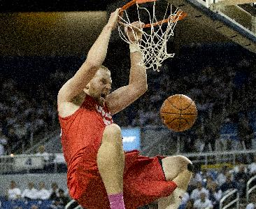 New Mexico's Alex Kirk dunks against Nevada during the first half of an NCAA college basketball game Sunday, March 2, 2014, in Reno, Nev