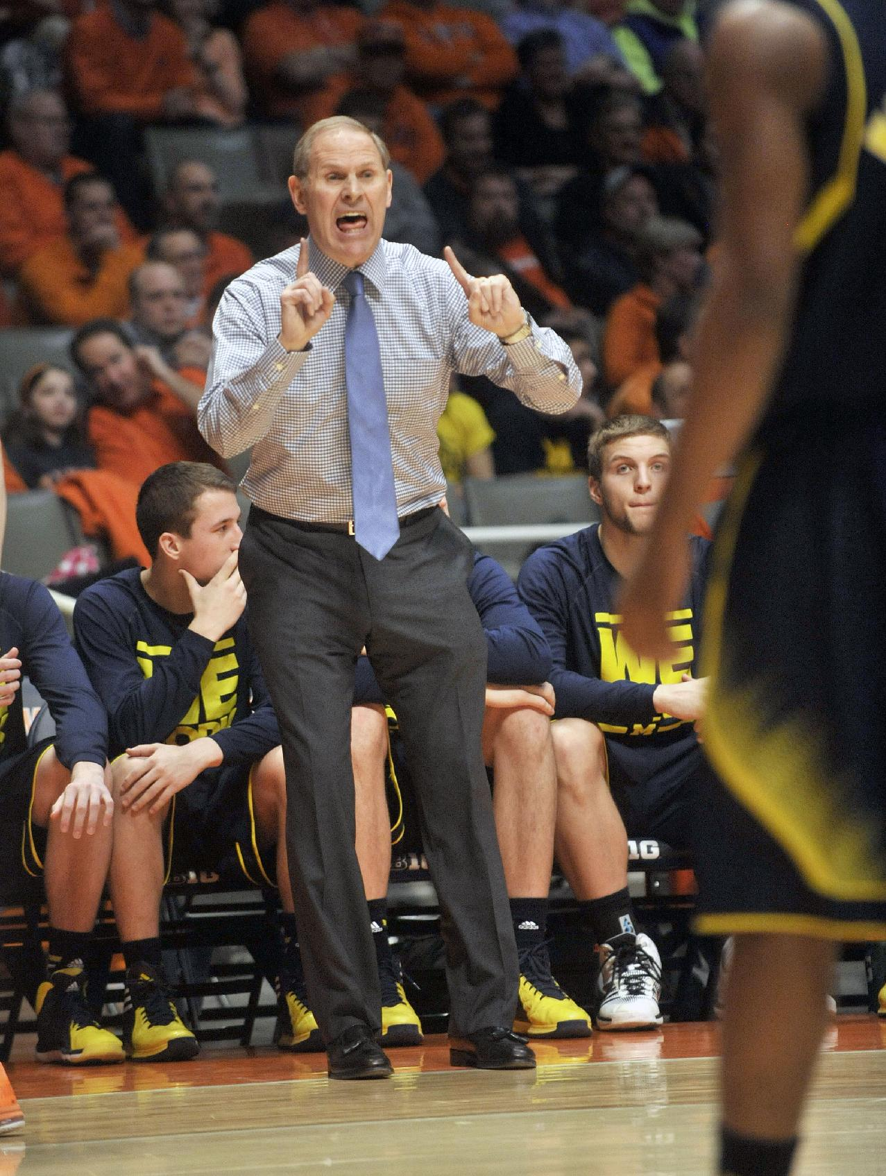 Michigan coach John Beilein shouts from the bench during the first half of Michigan's NCAA college basketball game against Illinois on Tuesday, March 4, 2014, in Champaign, Ill